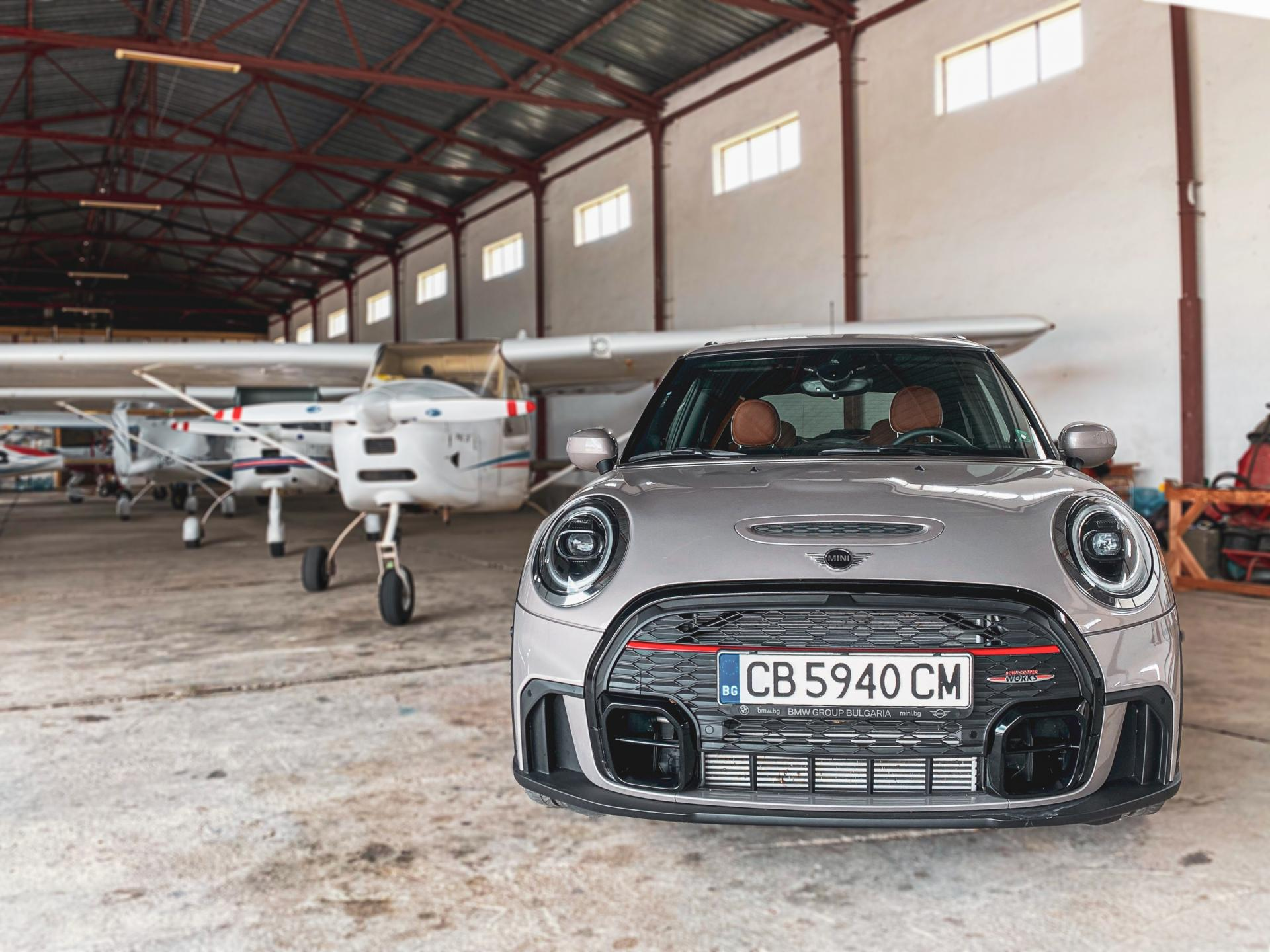 MINI JCW LCI in a Plane Hangar surrounded by small planes